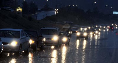 Les Stukenberg/The Daily Courier<br>Drivers on Highway 69 make their way through a heavy rainfall Oct. 4, 2010. The storm hit suddenly at 4:30 p.m. and turned the blue sky almost night-black.