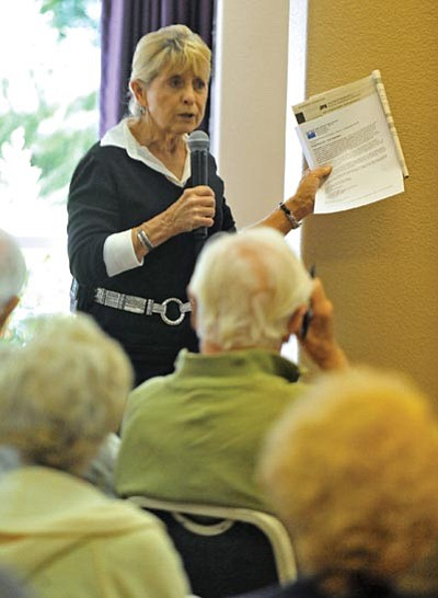 Matt Hinshaw/The Daily Courier<br> Sandra Goodwin of the League of Women Voters explains to the public Friday afternoon why she opposes Proposition 115, as part of  a 2012 General Election Ballot Town Hall at Las Fuentes Resort Village.