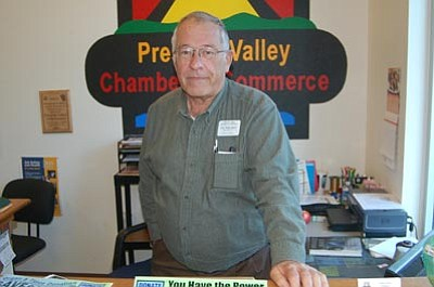 Ken Hedler/The Daily Courier<br>Cal Willahan, a heart transplant recipient, mans the desk of the Prescott Valley Visitor Center of the Chamber of Commerce Friday.
