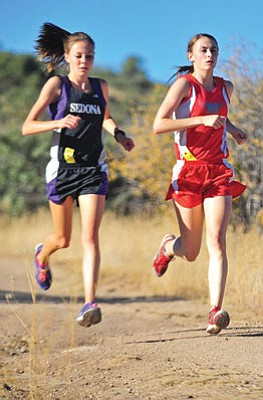 Matt Hinshaw/The Daily Courier<br>Mingus' Skyler Storie, right, battles with Sedona's Mykala Seresun for first place Wednesday afternoon during the 7th annual Yavapai County Cross Country Championship at Pioneer Park in Prescott. Storie won the varsity girls race for the second straight year.