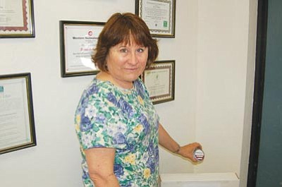 Ken Hedler/The Daily Courier<br> Toby Frost, manager of environmental services for Western Technologies Inc. in Prescott, displays a canister that she uses to test for radon gas from air samples. Federal Radon Action Week, which concludes Sunday, draws attention to the potential dangers radon poses inside homes.