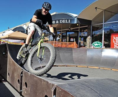 Matt Hinshaw/The Daily Courier<br>Steve Reynolds of Prescott rides through the Sombrio pump track during the second annual Wonderschlautt Festival at Park Plaza in downtown Prescott.