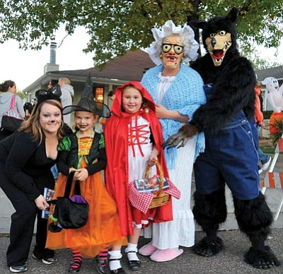 The Daily Courier/file<br> Red Riding Hood and friends trick-or-treat along Mt. Vernon in Prescott last year. Ensure costumes are not flammable, avoid poorly lit homes and carry a cellphone to help make Halloween horror-free.