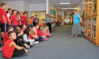 Matt Hinshaw/The Daily Courier<br>Terry Robertson, daughter of Abia Judd, talks about her father and the new Abia Judd memorial display Tuesday to Mrs. Chambers' fifth-grade class.