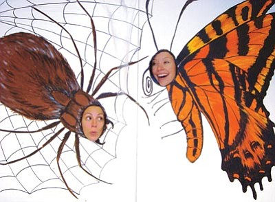 Courtesy HCNH<br> Visitors at Friday's Highlands Center Halloween Happening can pose as a spider and butterfly for photos, decorate pumpkins, and participate in many other activities.