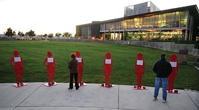 Les Stukenberg/The Daily Courier<br>Life-size cutouts of Arizona women who died as a result of domestic violence were on display at the Take Back the Night ceremony and vigil at the Prescott Valley Civic Center Wednesday night.
