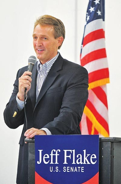 Matt Hinshaw/The Daily Courier<br> Jeff Flake, Arizona's Republican candidate for U.S. senator, talks about what he will do for constituents Saturday during a rally at the Prescott Airport.