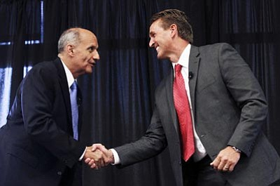 Ross Franklin/AP<br> Arizona U.S. Senate candidates Richard Carmona  (D) and Jeff Flake (R)  shake hands prior to a debate Oct. 18 in Chandler.  The two are vying for the open seat left by a retiring Sen. Jon Kyl.