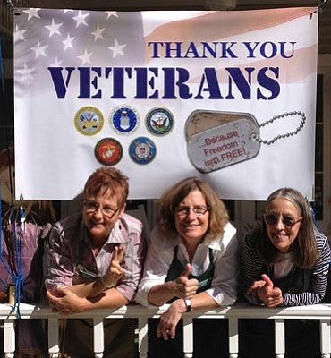 From left to right: Owner of Prescott Pines Inn, Dawn Delaney and innkeepers Dana McCready and Debbie Rasmus, give thumbs up to veterans.
