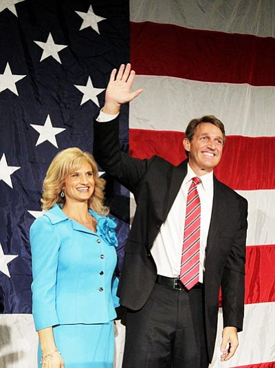 Matt York/The Associated Press<br> U.S. Rep. Jeff Flake, R-Ariz., and his wife Cheryl, wave during an election night party Tuesday at a hotel in Phoenix.
