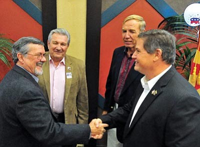 Matt Hinshaw/The Daily Courier<br> Yavapai County Supervisors elect from left, Rowle Simmons, Craig Brown, Tom Thurman, and Jack Smith congratulate each other after giving a speech together Tuesday night during the Yavapai County GOP election night party at the Prescott Resort.