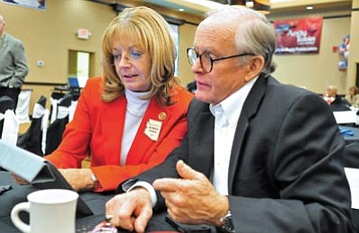 Matt Hinshaw/The Daily Courier<br> State Senator Steve Pierce and State Representative Karen Fann check election results on a tablet Tuesday night during the Yavapai County GOP election night party at the Prescott Resort.