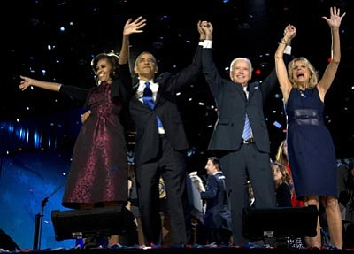 Carolyn Kaster/The Associated Press<br> President Barack Obama, first lady Michelle Obama, Vice President Joe Biden and Jill Biden celebrate at his election night party  in Chicago.