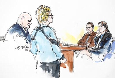 Bill Robles/AP<br> In this courtroom sketch, Mark Kelly, left, with his wife former Rep. Gabrielle Giffords by his side, speaks to Jared Loughner at U.S. District Court Thursday in Tucson, Ariz.