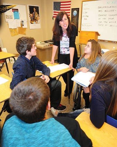 Les Stukenberg/The Daily Courier<br> Keri Milliken, the principal at Tri-City College Prep, works with students in a film study class she teaches at the school.