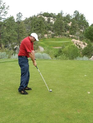 Les Stukenberg/The Daily Courier<br>Outside services attendent Joe DeFilipps hits from the tee to the 16th hole at Hassyampa Country Club in Prescott.