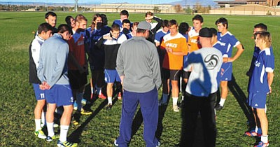 Les Stukenberg/The Daily Courier<br>The Embry-Riddle Aeronautical University men's soccer team meets for practice Tuesday afternoon as the team prepares to head to Portland, Ore., for the first round of the NAIA Soccer Tournament against Concordia University on Saturday.