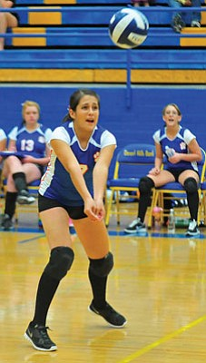 Matt Hinshaw/The Daily Courier<br>Chino Valley's Celeste Camargo (7) digs the ball during a match Oct. 9, 2012. Camargo led the Cougars in kills and kill percentage as well as in serving this fall.