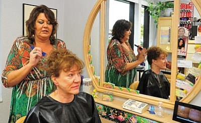 Matt Hinshaw/The Daily Courier<br>Wendy Clore gives Dyan Harper a cut and color Friday morning. Clore opened Over the Top Style Salon at 1000 Ainsworth Dr., Suite A, Prescott, this past April.