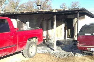Chino Valley Fire District/Courtesy photo<br> Chino Valley firefighters put out a fire early Thursday morning in the carport of a home on Bacon Lane.