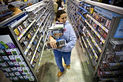 Alex Slitz/The Associated Press<br>Tonya Thomas makes her way through the aisles of Best Buy while shopping for deals Friday in Bowling Green, Ky.