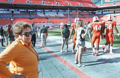 Wilfredo Lee/The Associated Press<br>A photo of UM President Donna Shalala, seen here before the start of Miami's football game against South Florida on Nov. 17, accepting a $50,000 check from Nevin Shapiro during a team banquet went viral after it was included in one of the Yahoo! Sports articles chronicling Shapiro's illicit activities