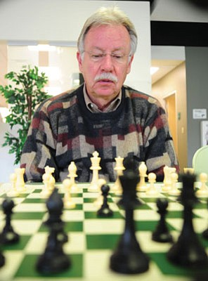 Les Stukenberg/The Daily Courier<br>A chess champion who has represented the U.S. in international competition, Prescott's Tom Green still gives back to the game he loves.