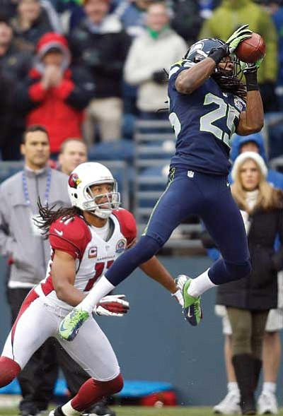 John Froschauer/The Associated Press<br> Seattle Seahawks cornerback Richard Sherman (25) intercepts a pass in front of Arizona Cardinals wide receiver Larry Fitzgerald (11), which was returned for a 19-yard touchdown during the second quarter of an NFL football game in Seattle on Sunday.