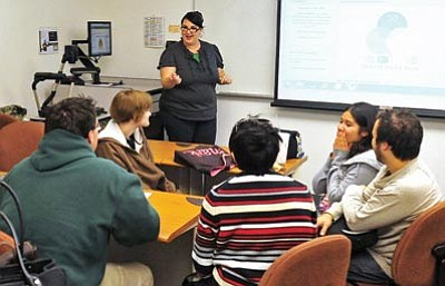Matt Hinshaw/The Daily Courier<br> Yavapai College Library Events Liason Ginney Bilbray asks for the participants' word counts for the month of November during the National Novel Writing Month Potluck in Prescott.