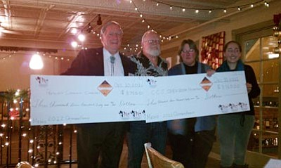 Brett Soldwedel/Courtesy photo<br>Prescott Community Cupboard Chairman Al Beeson, Leff-T's Steakhouse owner Daryl Davis, Coalition for Compassion & Justice (CCJ) Executive Director Gail Kenny and Vanessa Silverstein with CCJ-AmeriCorps VISTA pose at the Prescott Brewing Company Wednesday with checks made out for $3,750 each to the Prescott Community Cupboard Food Bank and CCJ.