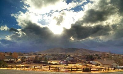 Les Stukenberg/The Daily Courier<br>Storm clouds start to build up over Glassford Hill in Prescott Valley Thursday afternoon.