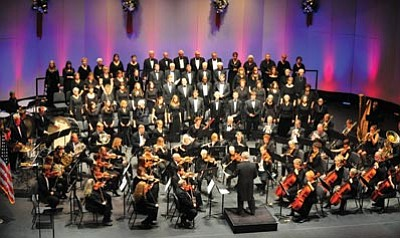 """Matt Hinshaw/The Daily Courier<br> The Prescott POPS Symphony performs the """"The Many Moods of Christmas"""" Friday night at the Yavapai College Performance hall in Prescott. The orchestra has made a major donation to local schools."""