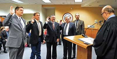 Matt Hinshaw/The Daily Courier<br>Judge David Mackey swears in County Supervisors Jack Smith, Chip Davis, Rowle Simmons, Craig Brown and Tom Thurman Tuesday morning at in Prescott.