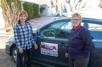Ken Hedler/The Daily Courier<br> Carol Stilwell, left, joins Toni Geiger of On the Move Relocation  Consultants outside Stilwell's Prescott Valley home. On the Move  helps businesses and homeowners move to other communities.
