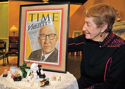 "Matt Hinshaw/The Daily Courier<br> Betty Nisi looks at a cover of Time Magazine featuring her father, who was instrumental in financing the first production of ""Harvey"" on Broadway in 1944. ""Harvey"" opens at the Prescott Center for the Arts in January."