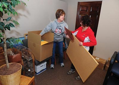 Les Stukenberg/The Daily Courier<br>Prescott Valley Chamber of Commerce President Marnie Uhl and executive assistant Beverly Oleson unpack boxes Friday morning in the chamber's new offices at 7120 East Pav Way in Prescott Valley.
