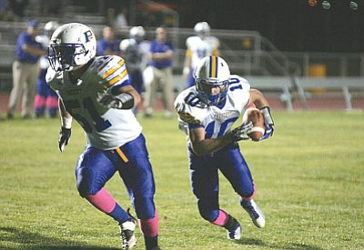 Rodney Haas, Kingman Daily Miner/Courtesy<br>Brady Mengarelli (10), seen in a Week 9 game at Kingman on Oct. 19, 2012, followed blockers like Willy Andrews all season long during a record-shattering campaign for Prescott.