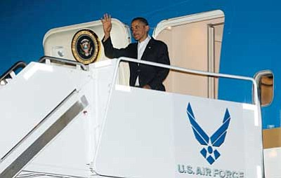 AP photo<br>  President Barack Obama waves as he gets off Air Force One upon his arrival at Joint Base Pearl Harbor-Hickam, Honolulu, Hawaii on Wednesday. The president is back in Hawaii for vacation after a tense standoff with Congress over the fiscal cliff.