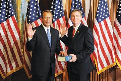 Courtesy photo<br>Speaker of the House John Boehner swears in Paul Gosar to the 113th Congress in Washington, D.C., Thursday.
