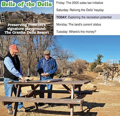 Matt Hinshaw/The Daily Courier<br /><br /><!-- 1upcrlf2 -->Dan Campbell and Jim Lawrence with the Granite Dells Preservation Foundation look at a map of the former Granite Dells Resort and swimming hole (pictured below) and discuss possible future trail developments on the property Dec. 7. The former resort could be the next open space purchase for the City of Prescott.