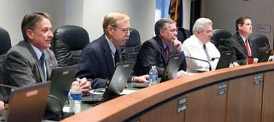 Les Stukenberg/The Daily Courier<br>  The Yavapai County Board of Supervisors begin their first meeting of the new year with five supervisors, from left, Chip Davis, Tom Thurman, Rowle Simmons, Craig Brown and Jack Smith.