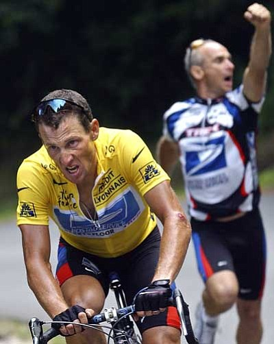 Christophe Ena, file/The Associated Press<br> Lance Armstrong, left, of the United States, makes the final ascent towards Luz-Ardiden during the 15th stage of the 2003 Tour de France cycling race between Bagneres-de-Bigorre and Luz-Ardiden, French Pyrenees. In 2003, Armstrong was named the Associated Press Male Athlete of the Year, ESPN's ESPY Award for Best Male Athlete and BBC Sports Personality of the Year Overseas Personality.