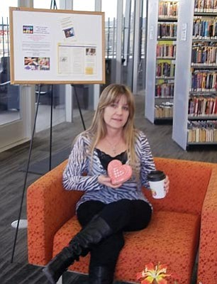 Courtesy photo<br>Robin Hall, West Yavapai Guidance Clinic employee and West Yavapai Guidance Clinic Foundation supporter, enjoys a cookie from CakeWorks Library Café.