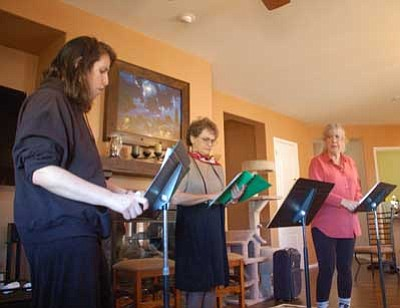 """Cindy Barks/The Daily Courier<br> Local actresses Rebecca Antsis, Julie Cargill, and Jean Lippincott, left to right, rehearse a scene in the military drama, """"This We'll Defend"""" Sunday morning at the home of Janel Taylor, the play's director. The """"readers' theater"""" rendition of the play will open this week at the Peregrine Book Company in downtown Prescott."""