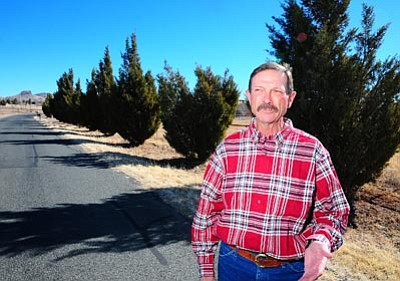 Matt Santos/Special to the Courier<br>Ron Weiss says a county official told him his trees had to go because they interfere with line-of-sight on Hackamore Road.