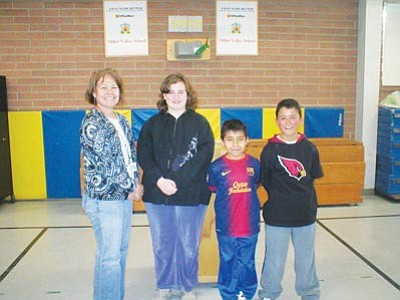Lisa Irish/The Daily Courier<br> Miller Valley fifth-grade teacher Sandy Spillman poses with spelling bee winners Ruby Dexter (third place), Aldo Munoz (first place) and Jose Contreras (second place).