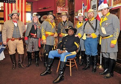 Matt Hinshaw/The Daily Courier<br> Members of the local Sons of Confederate Veterans group and a representative of the Prescott Regulators & Their Shady Ladies celebrate the birth of Robert E Lee at the Palace Saloon in downtown Prescott Saturday.