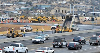 Matt Hinshaw/The Daily Courier<br /><br /><!-- 1upcrlf2 -->Construction crews pave the recent lane additions to Highway 69 in front of Frontier Village near the new Highway 89 and 69 connector road Thursday afternoon in Prescott.