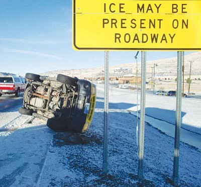 Prescott Valley Police Department/Courtesy photo<br> Prescott Valley Police, Central Yavapai Fire and Life Line Ambulance answered a call about a rollover Tuesday morning on Highway 69.