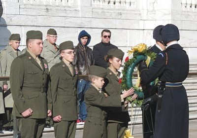 Courtesy photo<br /><br /><!-- 1upcrlf2 -->LCPL D. Lindquist, SSgt M. Reveile, Cpl I. Watson, and LCPL K. Bray lay a wreath at the Tomb of the Unknown Soldier at Arlington National Cemetery, Va.